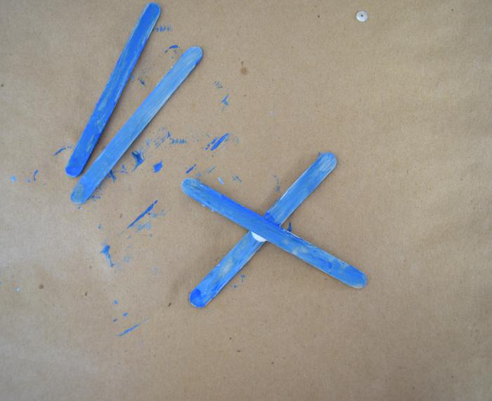 paint sticks in an X