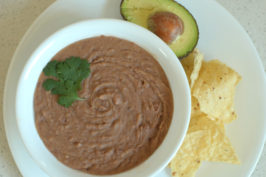 quick stovetop refried beans with chips and avocado